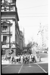 Pedestrians waiting at traffic lights corner of Swanston and Collins Streets, Melbourne [Mark Strizic, photographer] ca.1950-ca.1980, State Library of Victoria