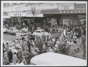 Large group of pedestrians crossing over Bourke Street, Melbourne, near the main entrance of Buckley and Nunn, ca. 1948 (Argus Newspaper Collection of Photographs, State Library of Victoria)